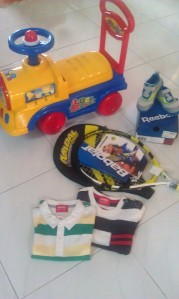 your birthday presents! - Babolat racquet from daddy, clothes from grandparents, shoes from auntie CY and bike from your ah pek.